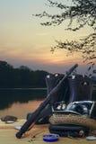 Fishing equipment on the lake at sunset Stock Image
