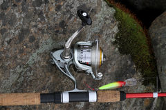 Fishing equipment. Fishing rod, reel and lure royalty free stock photography