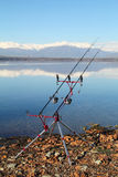 Fishing equipment and rods with lake in background Stock Images