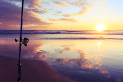 Fishing equipment with sunset background Stock Photos