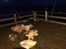 Fishing, Faith and Family. Peaceful day of fishing an Atlantic Ocean pier as a family Stock Image