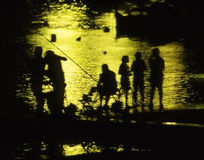 Fishing familiy in back-light Royalty Free Stock Images