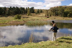 Fishing family. Father and daughter fishing together in a pond or dam Royalty Free Stock Images