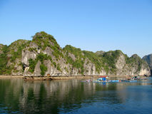 Fishing farm among limestone rocks in the sea Royalty Free Stock Photography