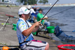 Fishing feeder competition. VYSHGOROD, UKRAINE - JUNE 7, 2014: Fishing competition Fishing Feeder Cup of Ukraine on the municipal embankment of the Kyiv sea in Royalty Free Stock Images