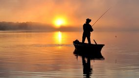 Fishing. Fisherman fishing early in the morning on the misty river. Dnipro river. Ukraine. Early autumn Royalty Free Stock Image