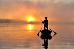 Fishing. Fisherman fishing early in the morning on the misty river. Dnipro river. Ukraine. Early autumn Royalty Free Stock Photos