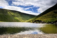 Fishing. A Fisherman on Hayeswater, England Royalty Free Stock Image