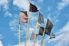 Fishing flags. Fishing buoy pennants on the blue sky Stock Images