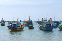 Fishing fleet anchored in front of village in Central Vietnam. Royalty Free Stock Images