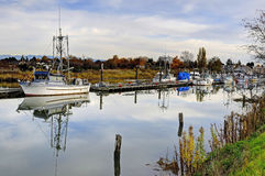 Fishing fleet anchoring in a bay Stock Photo