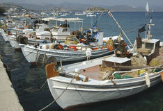 Fishing Fleet in Greek Isles. Small fleet of traditional Greek fishing boats tied up in port at Tolo Stock Photos