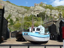 Fishing fleet. Old Town Hastings, UK. Fishing boat with cliff in background Stock Image