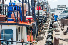 Fishing fleet rests in port. Fishing boats rest in port of Auckland, New Zealand Stock Photos