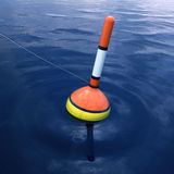 Fishing float. On blue water royalty free illustration