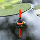 Fishing float in the pond Stock Photography