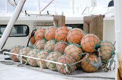 Fishing Floats. Floats for commercial fishing nets wrapped securely on the deck of a boat Royalty Free Stock Photos