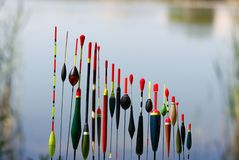 Floats. Fishing floats in different shapes on blurred background Royalty Free Stock Photography