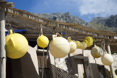 Fishing floats hanging on porch Stock Photos