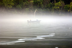 Fishing in fog royalty free stock images