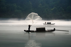 Fishing in the fog river. Fishing in the river with morning fog Royalty Free Stock Images