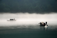 Fishing in the fog river. Fishing in the river with morning fog Royalty Free Stock Photography