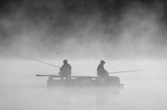 Fishing in the fog Stock Image