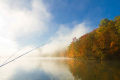 Fishing on a foggy fall morning Stock Photos