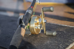Fishing freshwater tackles on the brown table. Fishing tackles stay on the table Royalty Free Stock Images