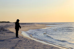 Free Fishing From The Shore At Sunrise Royalty Free Stock Photos - 27456858