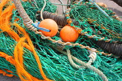 Fishing Gear. Close up focussing on the colours and textures of fishing nets and gear. Frame includes fishing nets, floats weight and ropes stock photography