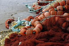 Fishing gear. Close view of several fishing gear on the floor, including floaters and nylon string Stock Image