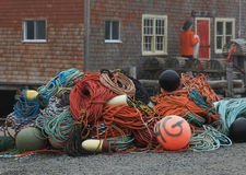 Fishing Gear. Fishing buoys and lines in a pile Royalty Free Stock Photos