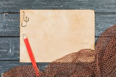 Fishing gear - fishing, hooks and baits, a wooden background stock images