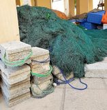 The fishing gear. Fishing nets are ready for a new catch royalty free stock photos