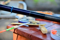 Fishing gear and gears are on the table, hooks, floats, loads. royalty free stock photography