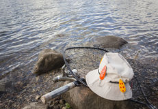 Fishing gear lying on a rock in the water. Stock Photography