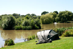 Fishing gear & tent beside lake Stock Photography