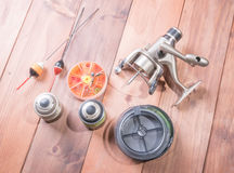 Fishing gear on wooden background. Fishing line, the spool for the coil floats Royalty Free Stock Images