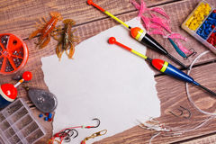 Fishing gear on wooden boards Stock Photo