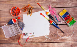 Fishing gear on wooden boards Stock Photography