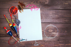 Fishing gear on wooden boards with empty place Stock Images