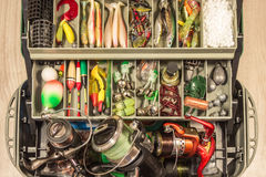 Fishing gears equipment tackle box, baits fisherman reel wobblers jig float feeder. Royalty Free Stock Image