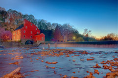 Fishing Ghosts. Men fishing in the early evening in front of the famous Clinton Red Mill Royalty Free Stock Images