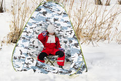 Fishing girl. Little girl on the ice fishing in the tent stock photos