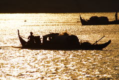 Fishing for Gold. Taken in Cambodia Siam Reap River, Vietnamese fishing boats during dusk Royalty Free Stock Photography