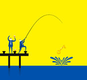 Fishing a gold key Stock Image