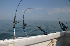 Fishing on the  Great Lakes. A rod and reel and downrigger used for fishing on the great lakes and oceans Stock Images