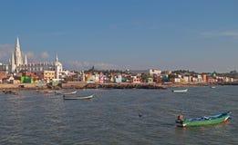 Fishing harbor with large church in background, KanyaKumari Royalty Free Stock Photography