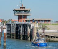 Fishing harbor in North Sea Schleswig-Holstein with various fish cutters royalty free stock photo